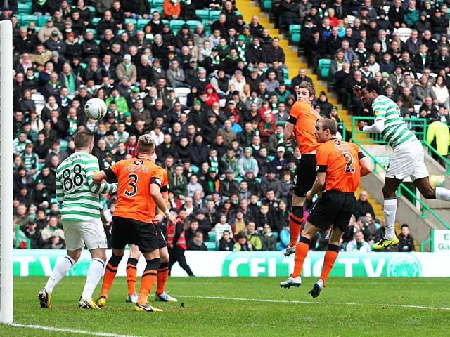 Celtic's Efe Ambrose heads in the equaliser against Dundee United on February 16, 2013