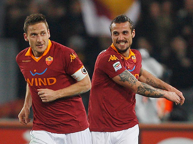 Roma's Francesco Totti celebrates with team mate Pablo Osvaldo after scoring the opener against Juventus on February 16, 2013