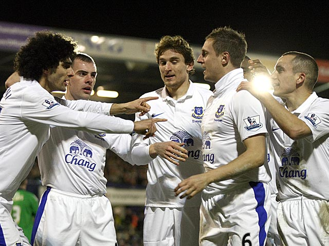 Everton's Phil Jagielka is congratulated by team mates after scoring his team's second against Oldham in the FA Cup 5th round on February 16, 2013
