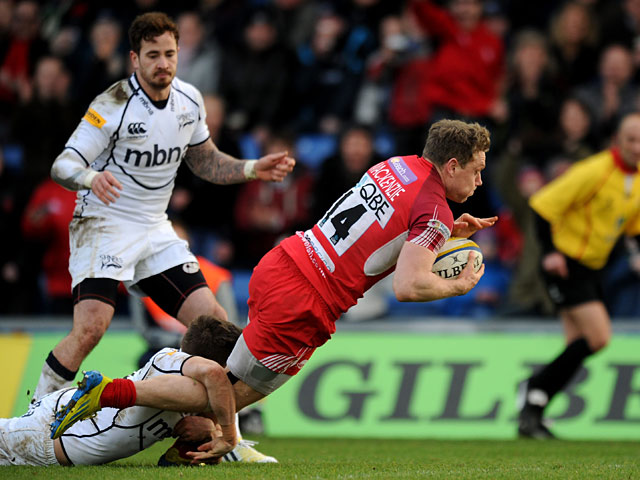 London Welsh's Phil MacKenzie dives over to score a try against Sale Sharks on February 17, 2013