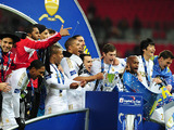 Swansea City players celebrate with the Capital One Cup trophy after defeating Bradford City in the final on February 24, 2013