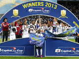 Swansea City players celebrate with the Capital One Cup trophy on February 24, 2013