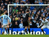 Man City forward Carlos Tevez makes it 2-0 against Chelsea on February 24, 2013