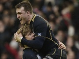 Scotland players Dave Denton and Stuart Hogg celebrate Six Nations victory over Ireland on February 24, 2013