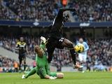 Chelsea striker Demba Ba is fouled by Joe Hart, winning a penalty in the game on February 24, 2013