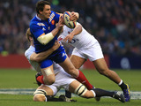 France's Louis Picamoles is tackled by two England players during the RBS Six Nations match on February 23, 2013