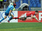 Alex Cuthbert scores a try for Wales in their match with Italy on February 23, 2013