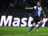 Porto's Joao Moutinho celebrates a goal against Malaga on February 19, 2013