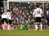 Fulham 'keeper Mark Schwarzer saves a penalty from Stoke's John Walters on February 23, 2013