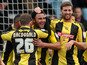 Burton Albion's Marcus Holnes celebrates with teammates after scoring against Exeter on February 23, 2013