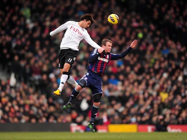 Fulham's Bryan Ruiz battle with Stoke's Glenn Whelan during a game on February 23, 2013