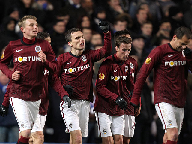 Sparta Prague's David Lafata celebrates with team mates after scoring the opening goal against Chelsea on February 21, 2013