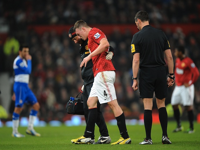Man Utd defender Phil Jones leaves the field injured against Reading on February 18, 2013