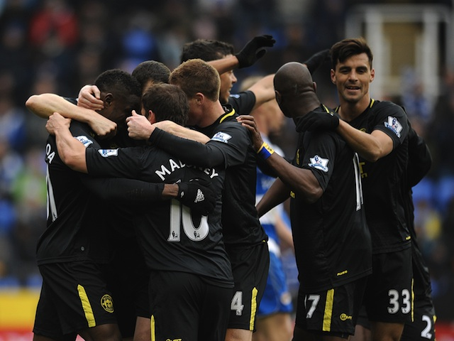 Players of Wigan Athletic celebrate a goal by Aruna Kone against Reading on February 23, 2013