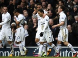 Spurs players congratulate Aaron Lennon after he put them 2-0 up against Arsenal on March 3, 2013