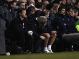 Arsenal manager Arsene Wenger sits in the dugout as his team lose 2-1 to Spurs on March 3, 2013