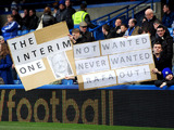 Fans hold up banners regarding Chelsea interim manager Rafael Benitez before their match with West Bromwich Albion on March 2, 2013