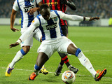 Porto's Eliaquim Mangala holds of Manchester City's Mario Balotelli on February 16, 2012