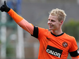 Dundee United's Gary MacKay-Steven celebrates his team's win after the final whistle in the Scottish Cup quarter final against rivals Dundee on March 3, 2013