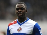 Reading's Hope Akpan in action against Wigan on February 23, 2013