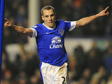 Everton's Leon Osman celebrates scoring the his team's third in the FA Cup 5th round replay against Oldham on February 26, 2013