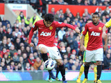 Manchester United's Shinji Kagawa shoots to score the opening goal against Norwich on March 2, 2013