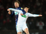 Paris Saint Germain's David Beckham and Olympique Marseille's Joey Barton clash during Coupe de France match on February 27, 2013