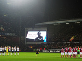West Ham United and Tottenham Hotspur players stand in memory of ex-West Ham United player and England captain Bobby Moore prior to kick off on February 25, 2013