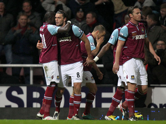 West Ham's Andy Carroll celebrates with teammates after scoring against Tottenham Hotspur on February 25, 2013