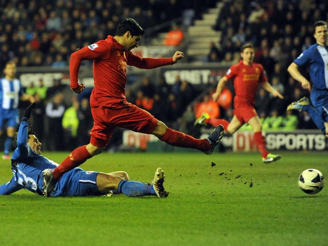 Liverpool's Luis Suarez scores his hat-trick goal against Wigan on March 2, 2013