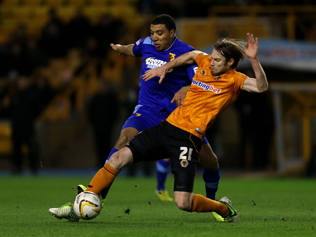 Wolverhampton Wanderers Kaspars Gorkss is tackled by Watford's Troy Deeney during the Championship match on March 1, 2013