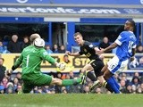 Wigan's Callum McManaman scores the second against Everton on March 9, 2013