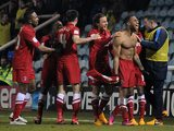 Charlton's Danny Haynes is congratulated by team mates after scoring his team's second against Peterborough on March 5, 2013