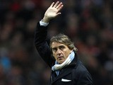 Manchester City manager Roberto Mancini waves during his side's FA Cup match with Barnsley on MArch 9, 2013
