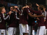 Hearts midfielder Ryan Stevenson is congratulated by team mates after scoring the opener against St Johnstone on March 5, 2013