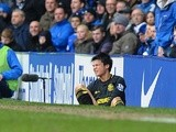 Wigan's on-loan midfielder Ryo Miyaichi sits injured during the game with Everton on March 9, 2013