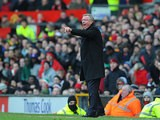 Manchester United boss Sir Alex Ferguson gestures to his team from the touchline during the FA Cup quarter final clash with Chelsea on March 10, 2013