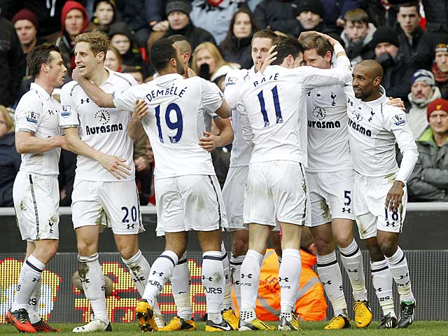 Spurs defender Jan Vertonghen is congratulated by team mates moments after heading in the equaliser against Liverpool on March 10, 2013