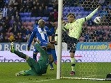 Aruna Kone pokes home Wigan's winner against Newcastle on March 17, 2013