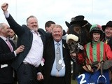Benefficient's owners and jockey celebrate after a win at Cheltenham on March 14, 2013