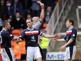 Dundee's Gary Irvine receives a red card during his side's Scottish Premier League clash against Dundee United on March 17, 2013