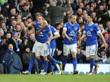 Everton's Leon Osman celebrates scoring against Manchester City on March 16, 2013