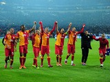 Galatasaray's players celebrate at the end of the game after knocking Schalke out of the Champions League on March 12, 2013