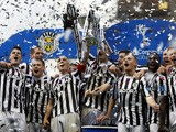 St Mirren players lift the cup after winning the Scottish League Cup final on March 17, 2013