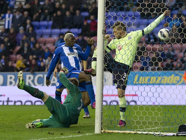 Aruna Kone pokes home Wigan's winner against Newcastle on March 17, 2013