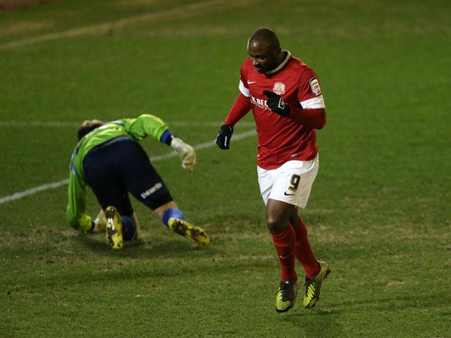 Barnsley's Jason Scotland celebrates scoring against Brighton in the Championship clash on March 12, 2013