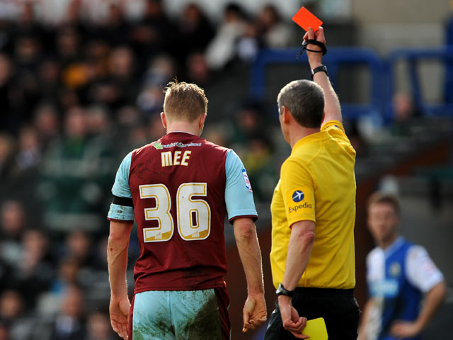 Burnley's Ben Mee is shown a red card during the Championship clash with rivals Blackburn on March 17, 2013