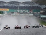 F1 drivers go round a corner at an early stage of the Malaysian Grand Prix on March 24, 2013