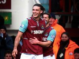 Andy Carroll is congratulated by team mate Matt Jarvis after scoring his second against West Brom on March 30, 2013