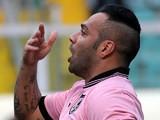 Palermo's Fabrizio Miccoli celebrates his goal against Roma on March 30, 2013